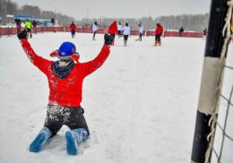 A participant wearing Valenki traditional Russian felt boots bearing the 2018 FIFA World Cup logo reacts during a friendly football match between media representatives and foreign students in a snow-covered field outside Nizhny Novgorod on January 21, 2018. The match aims at promoting the upcoming World Cup held in Russia, by focusing on the traditional Russian felt boots Valenki made from sheep's wool and resisting temperatures down to minus 60 degrees Celsius. / AFP PHOTO / Mladen ANTONOV